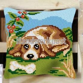 kruissteekkussen hond met bot